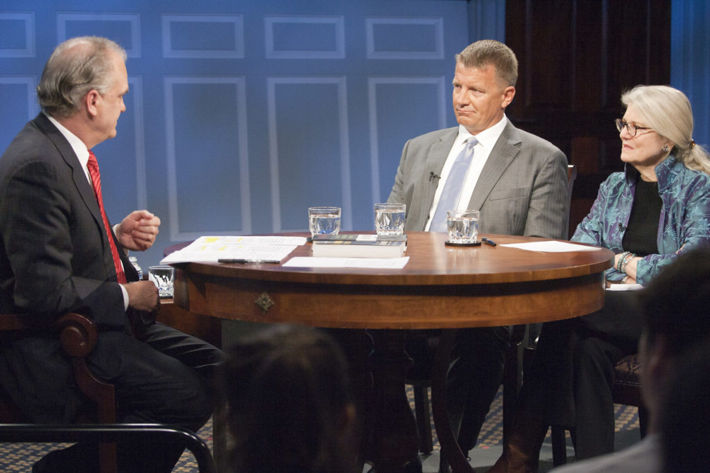 Erik Prince (center) in April 2015. Image courtesy of the Miller Center at the University of Virginia.