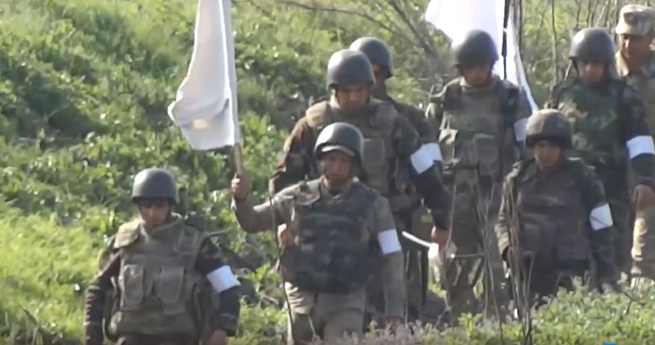 Azerbaijani personnel walk towards Armenians positions near Seysulan to pick up bodies of personnel killed in April 2016. Image grab from video by Arshak Zakaryan.