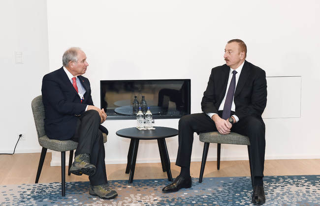 Aliyev at a recent meeting David Rubenstein of the Carlyle Group, one of several U.S. asset management firms that hold Azerbaijan's oil revenues. Official photo.