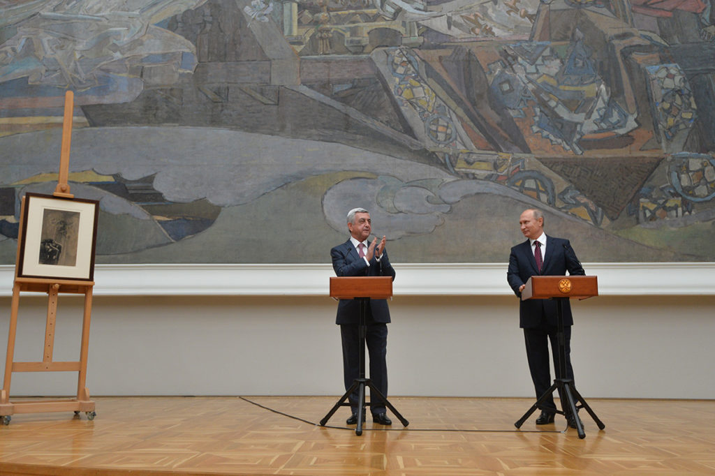 "On Nov. 15, Putin presented Sargsyan with a 19th cent. Mikhail Vrubel painting ""Demon and Angel with the soul of Tamara,"" stolen from a Yerevan gallery in 1995. Sargsyan was Armenia's National Security Service director at the time. Official photo."