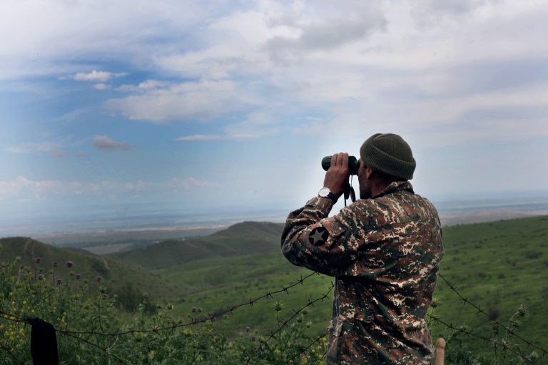 Armenian serviceman observing Azerbaijani positions. Image courtesy of CivilNet.