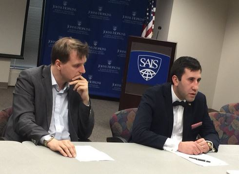 Ruben Melikyan (right) speaking at Johns Hopkins University in Washington on March 15. Image courtesy of ANCA.