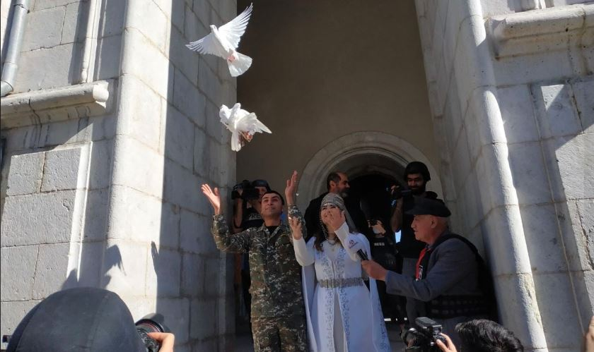 Focus on Karabakh - News in Context - Wedding was held in the Shushi Cathedral on Oct. 25 weeks after it was hit by missiles. Photo via Karabakh Records.